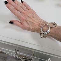 Donna from Orange, California, USA, wearing her handcuff bracelet
