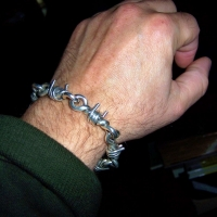 Barb Wire bracelet worn by Chris